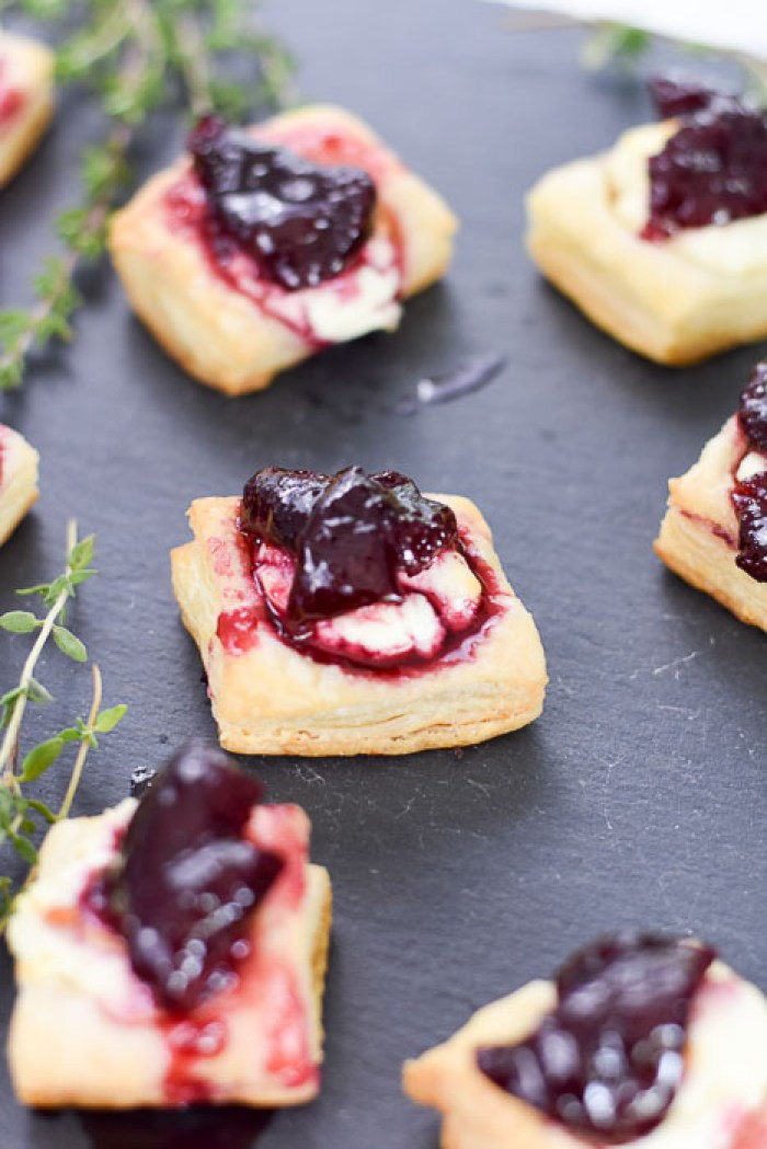 puff pastry appetizer bites topped with goat cheese and cherry thyme compote