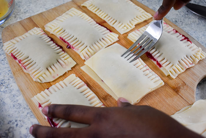 crimping edges of unbaked homemade cherry pop tarts