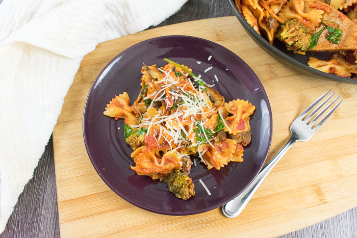 pasta skillet dinner topped with parmesan cheese