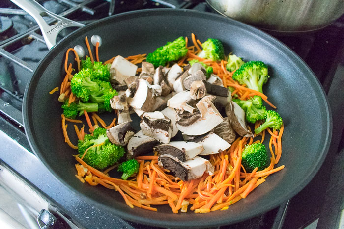 carrots, broccoli, and mushrooms in skillet