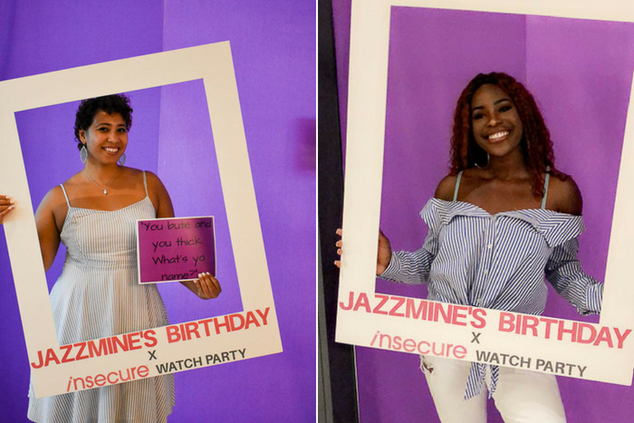 girls in insecure watch party photo booth