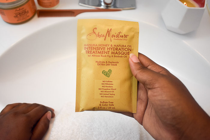holding shea moisture intensive hydration masque pack
