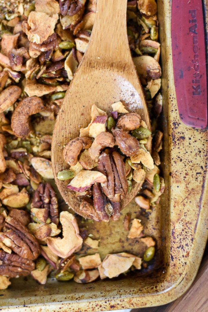 grain-free apple cinnamon granola on wooden spoon
