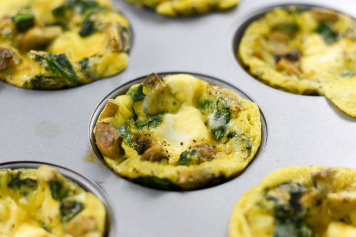egg muffins with goat cheese, mushrooms, spinach, and garlic