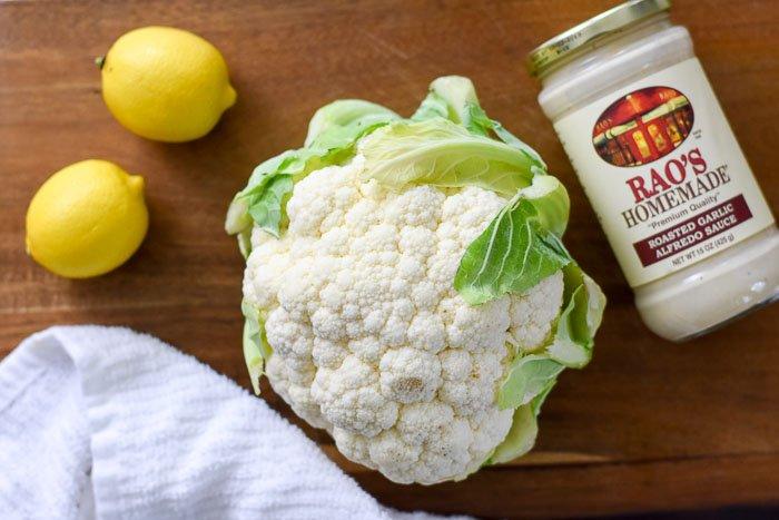 head of cauliflower, lemons, and Rao's Homemade alfredo sauce