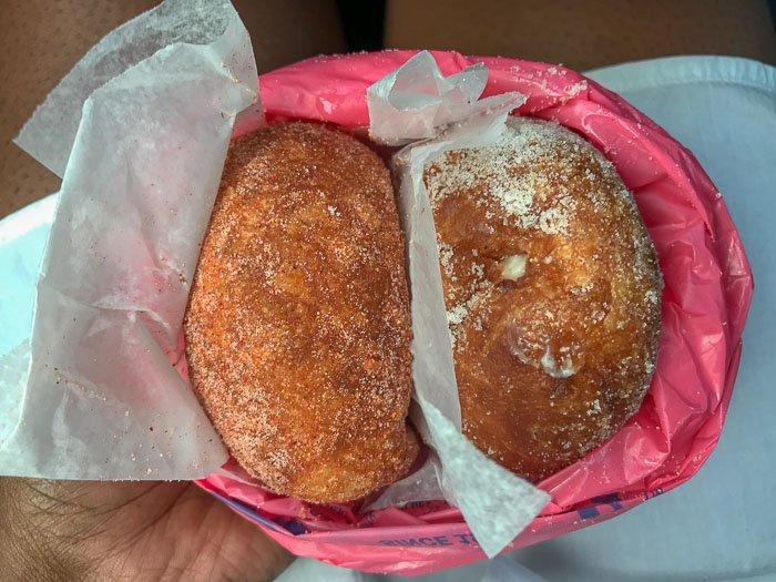 Hi Ling and Macadamia filled malasadas at Leonard's Bakery Oahu Hawaii