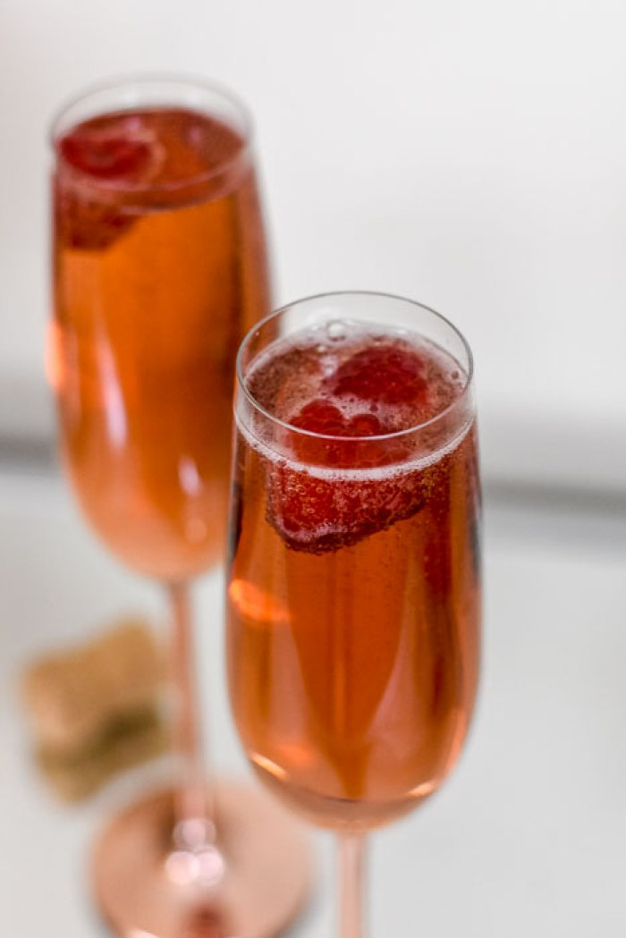 whiskey champagne cocktails with fresh raspberries