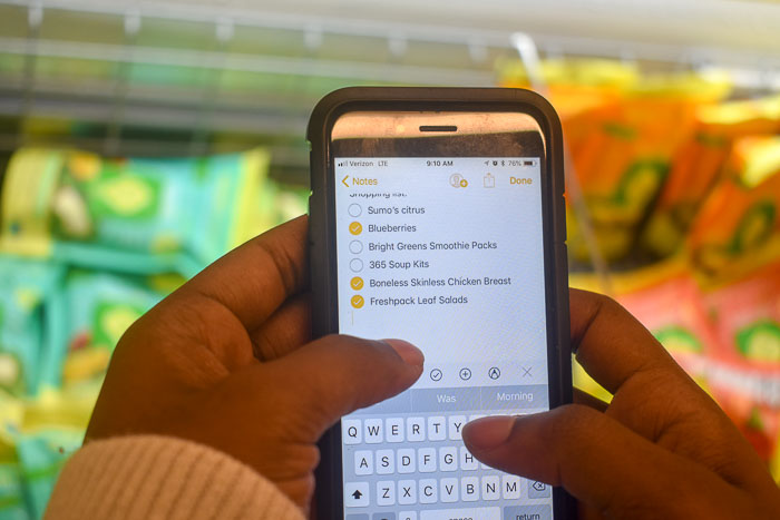 checking off grocery shopping list on iPhone