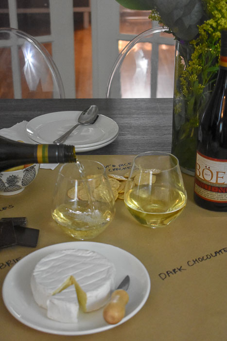 pouring Chardonnay into wine glasses