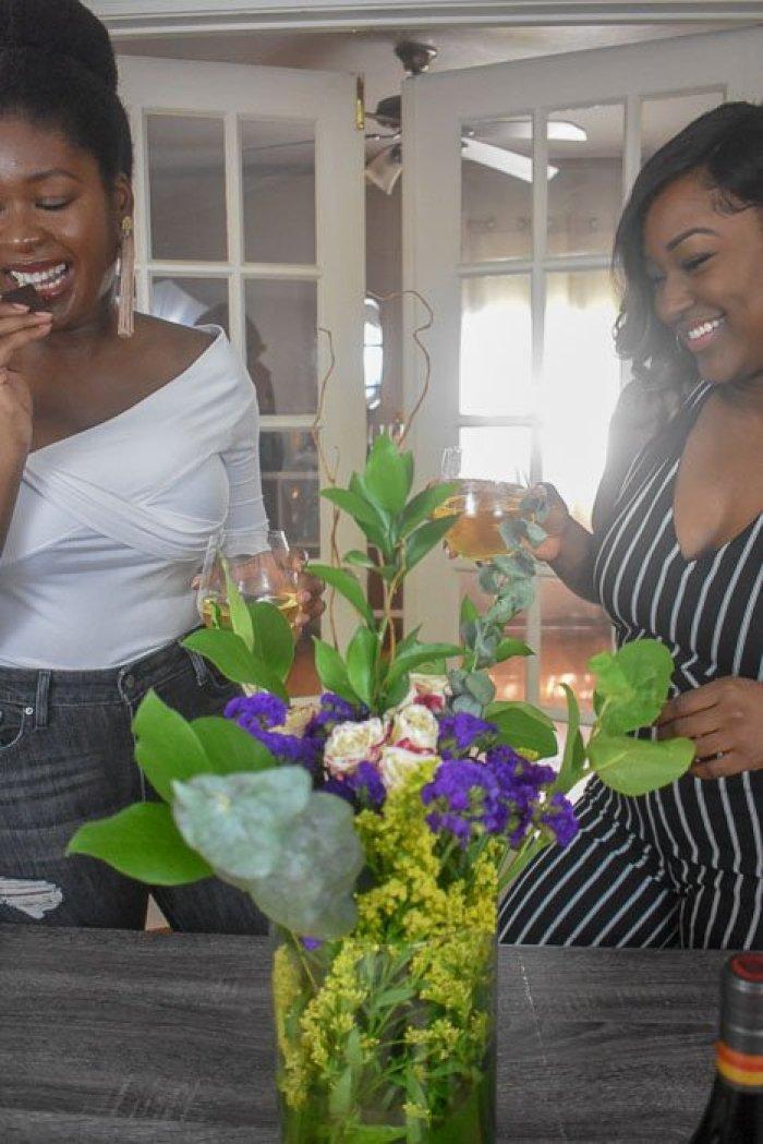 black women enjoying wine and chocolate