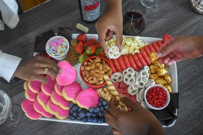 grabbing treats off dessert board