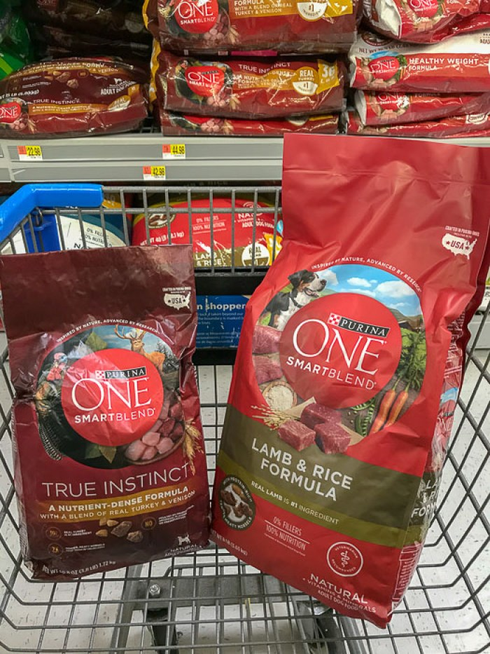 Purina ONE Smart Blend dog food in shopping cart at Walmart