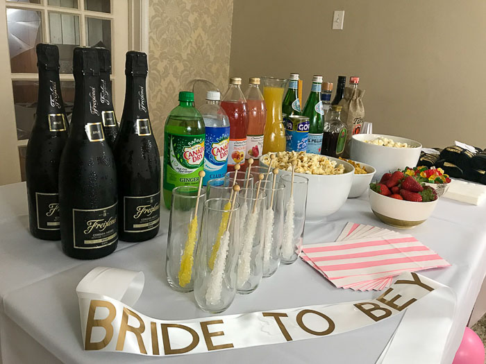 Beyoncé bachelorette party tablescape with favors, snacks, and beverages
