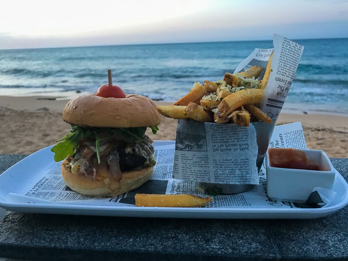 burger and truffle fries at Serafina Beach Hotel pool