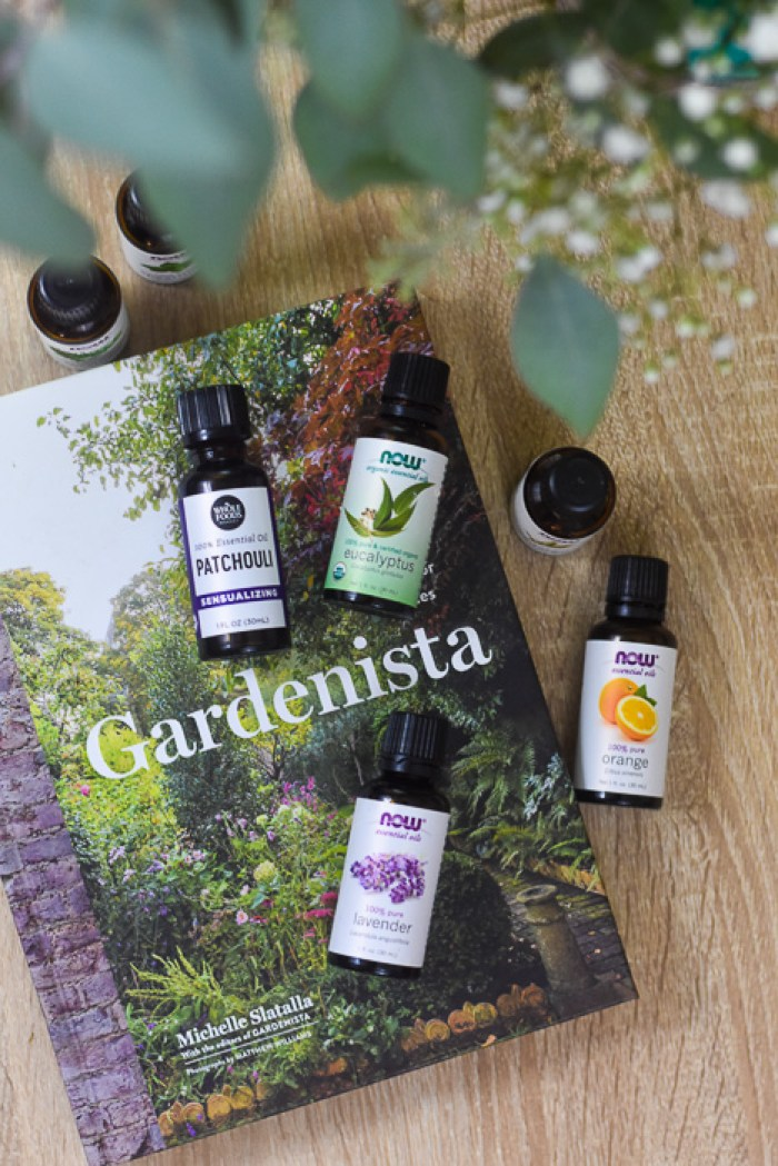 essential oil bottles and Gardenista book on coffee table