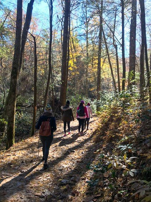 women hiking to long creek falls, GA