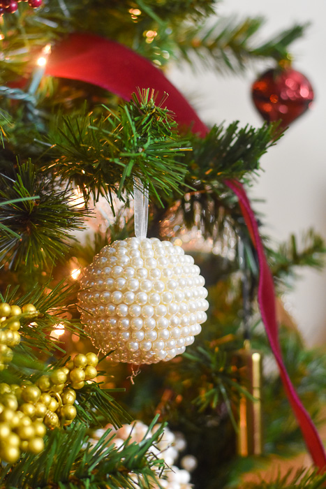 beaded pearl Christmas ornament on tree