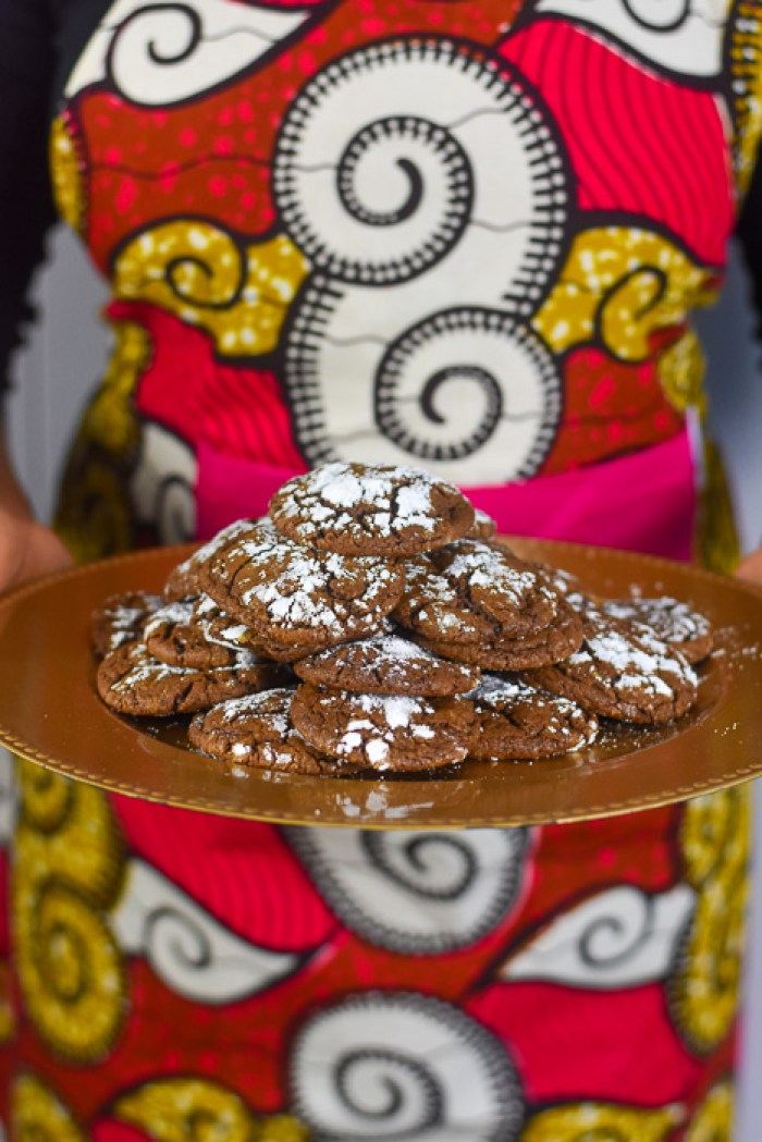 holding platter of chew gingerbread cocoa cookies