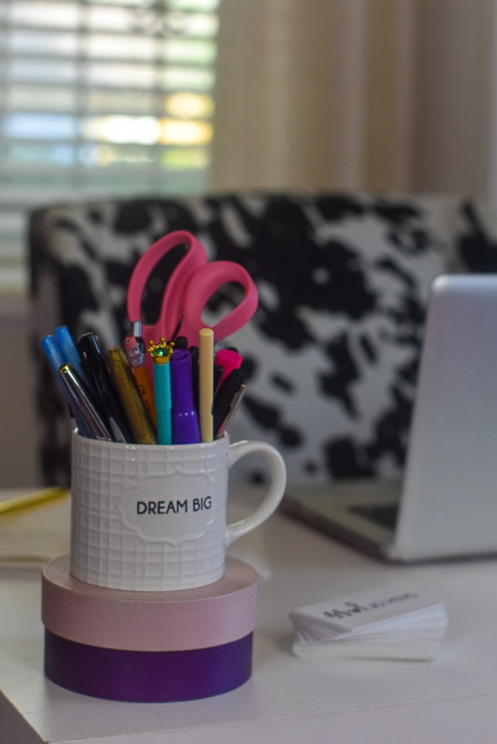 mug used as pen holder on girl boss desk