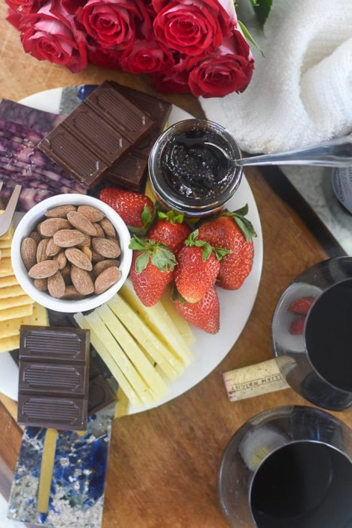 chocolate, almonds, cheese, and berries on a date night cheese plate for two