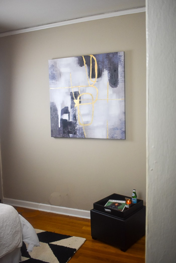 abstract painting on guest bedroom wall
