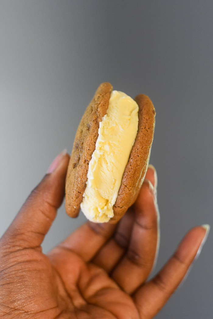 holding cookie butter cookie ice cream sandwich