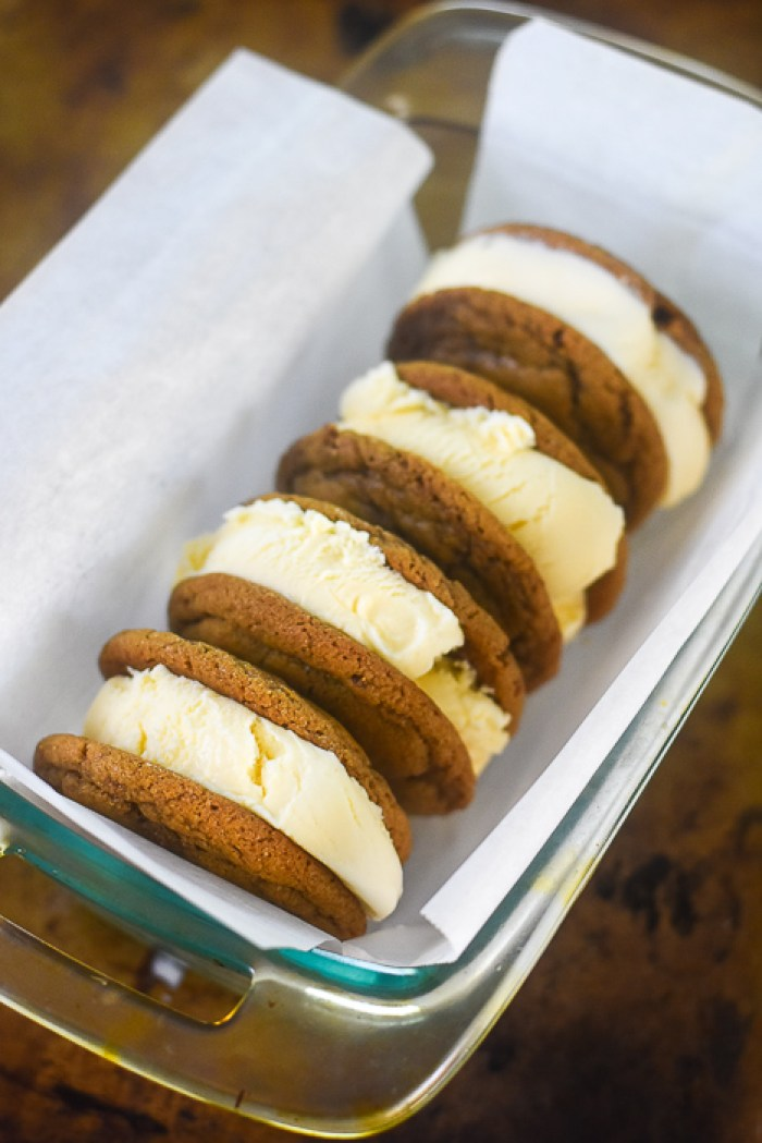 four cookie butter cookie ice cream sandwiches
