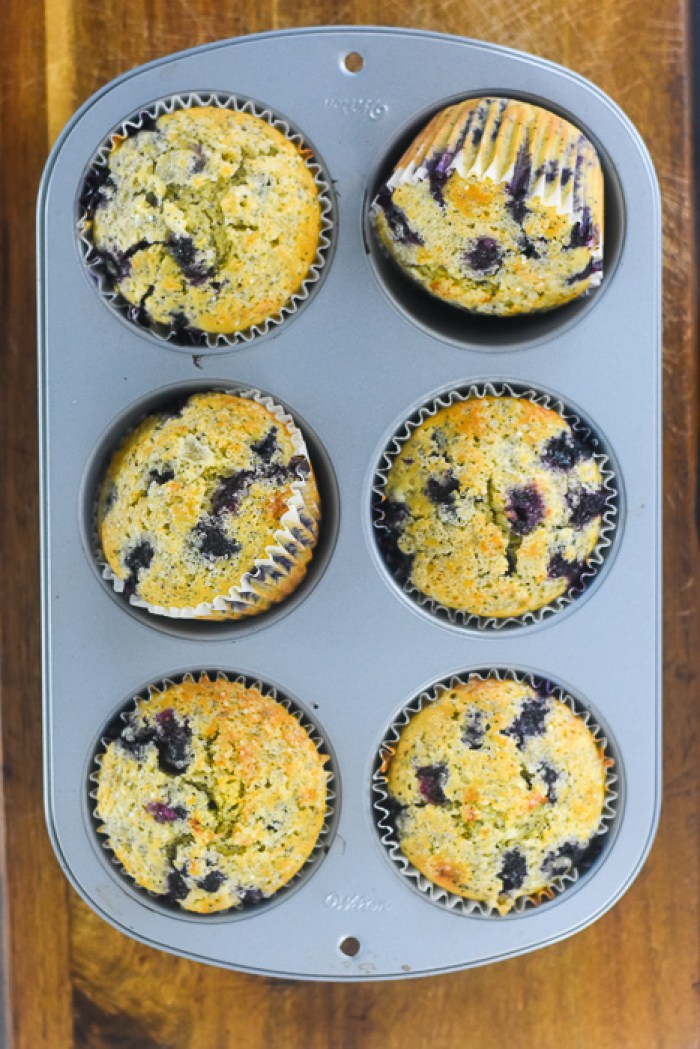 jumbo blueberry lemon poppyseed muffins in pan