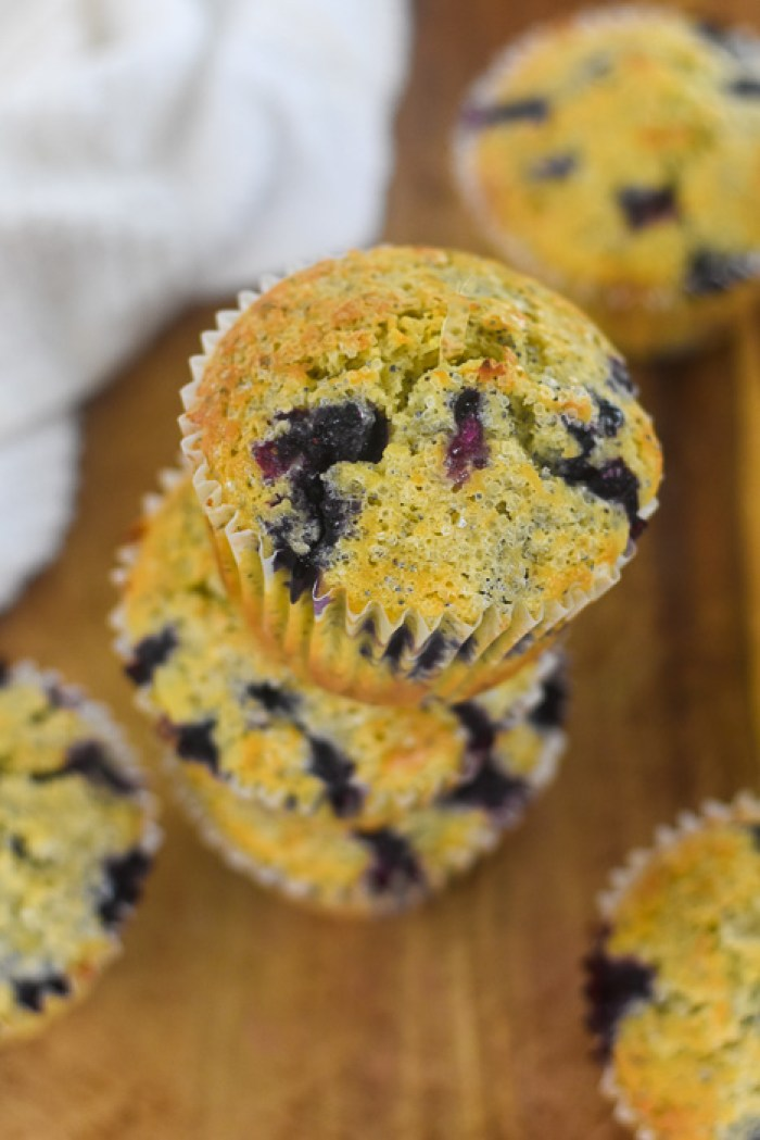 jumbo lemon blueberry poppyseed muffins on cutting board
