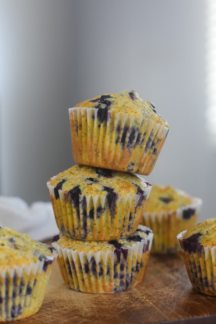 stack of lemon blueberry poppyseed muffins