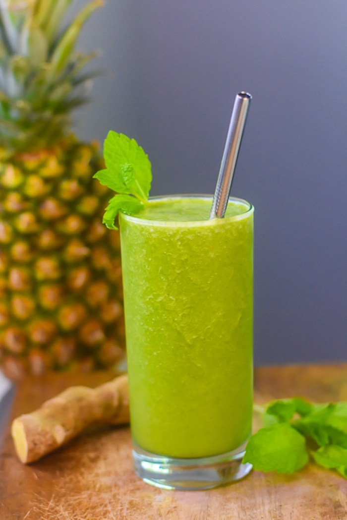 green smoothie garnished with fresh mint