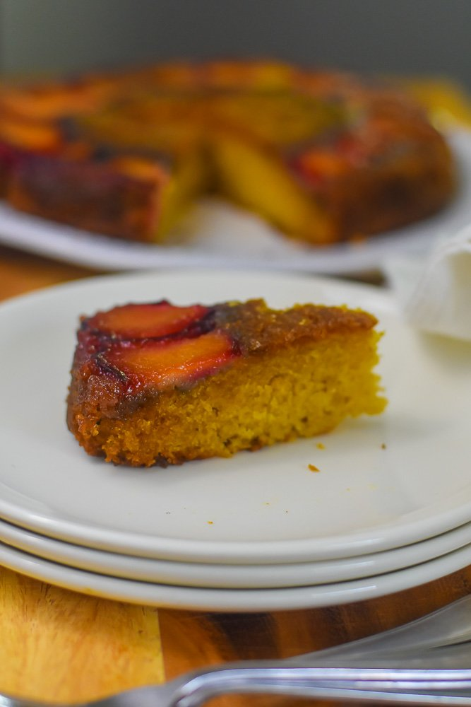 slice of bourbon plum upside down cake on plate