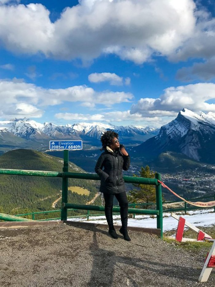 Jazzmine standing at lookout point on Mount Norquay