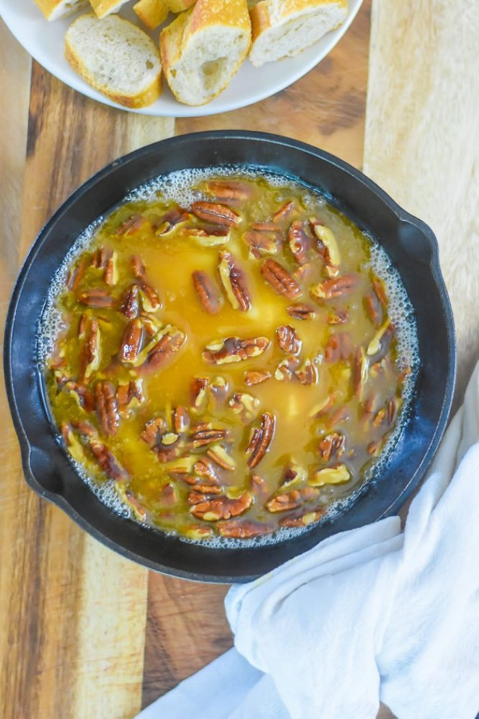 praline baked brie dip in small cast iron skillet