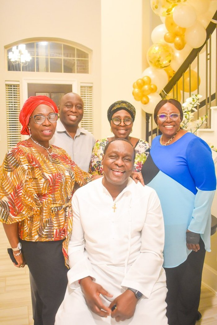 60th birthday celebrant laughing with sibling