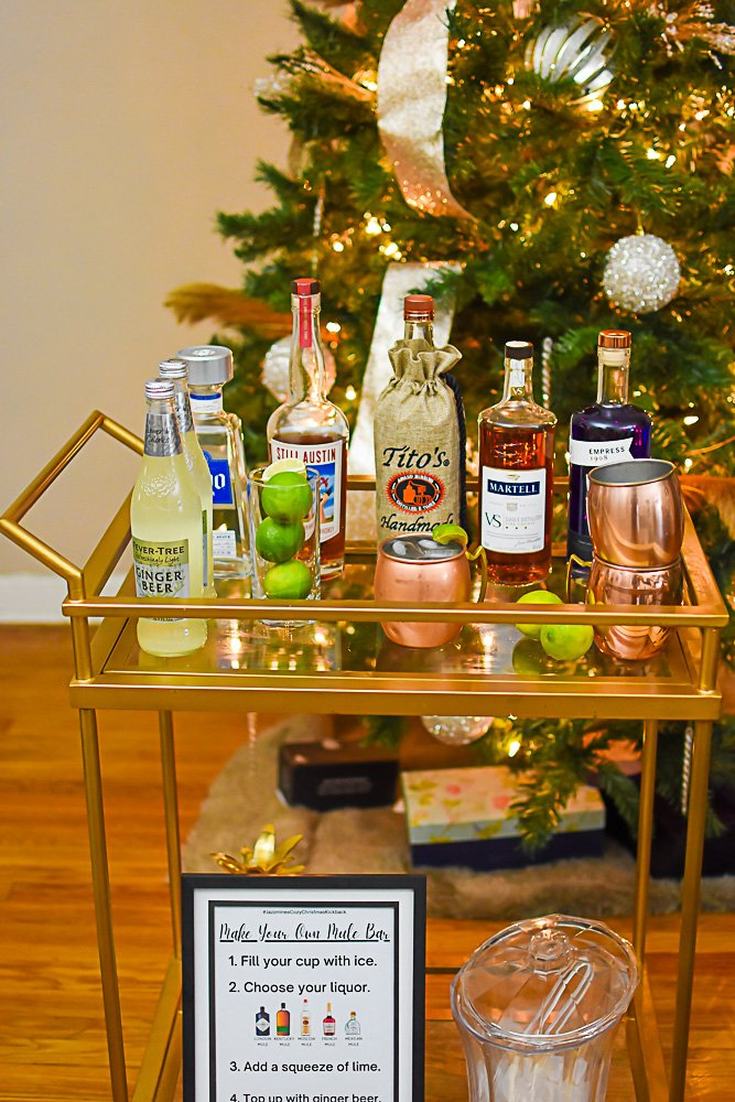 gold bar cart styled with ingredients to make mule cocktails