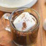 mug of bourbon gingerbread hot cocoa with jumbo marshmallow on top