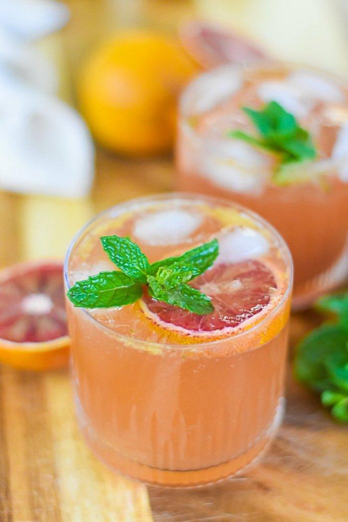 blood orange bourbon cocktails in rocks glasses