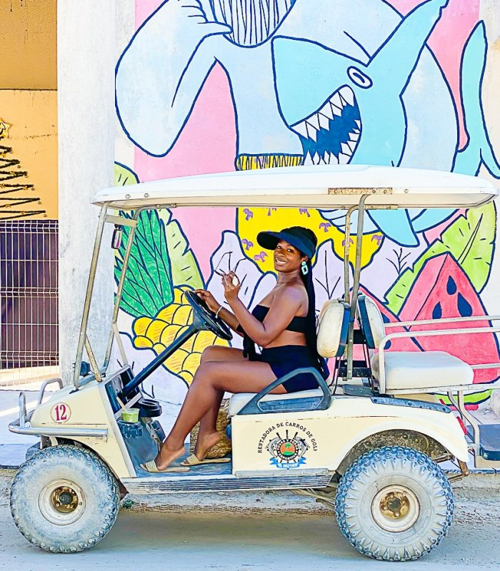 Jazzmine posing in golf cart on Holbox Island