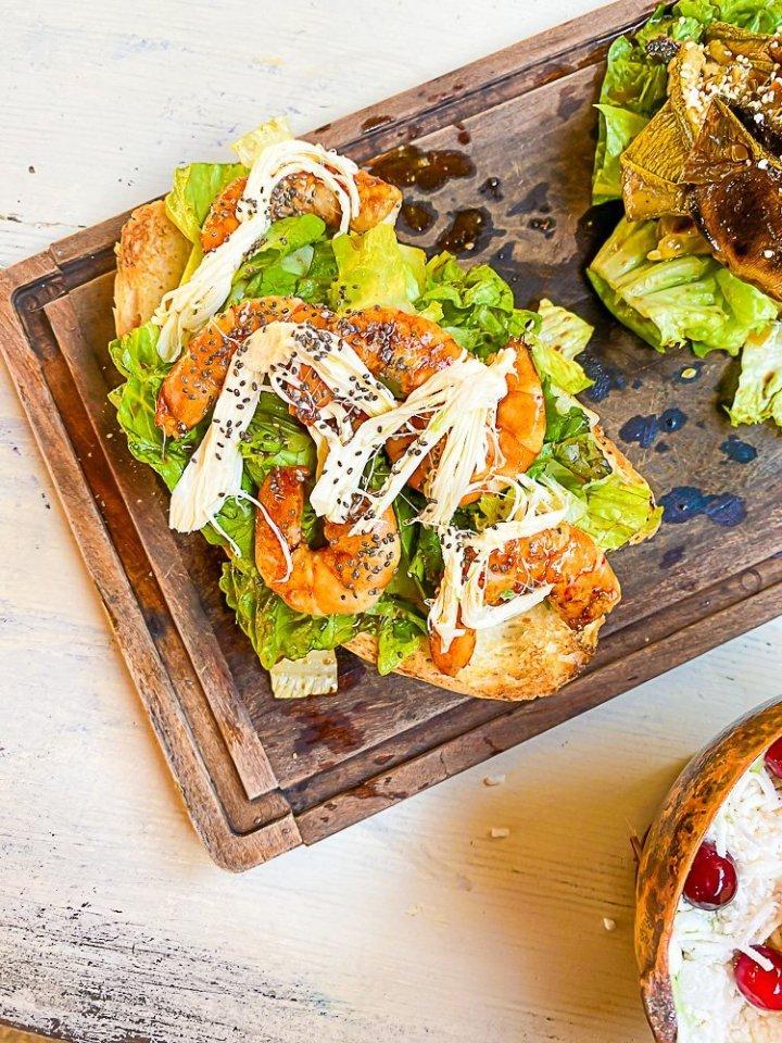 shrimp crostone on wood platter