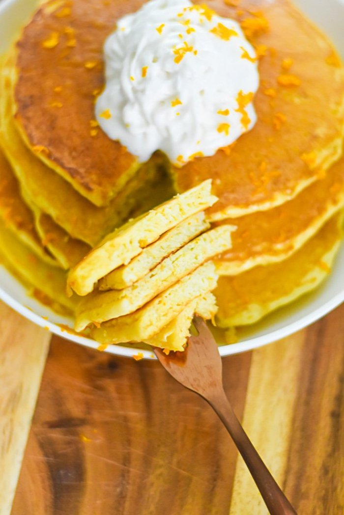 stack of mimosa pancakes on fork.