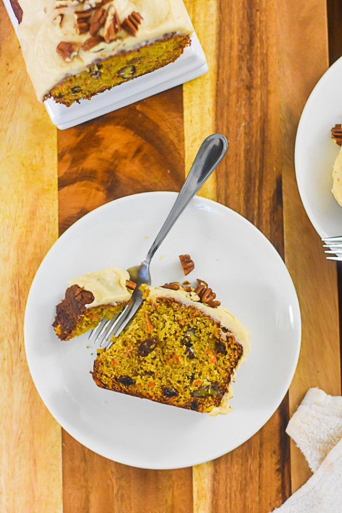 slice of carrot cake on plate with fork.
