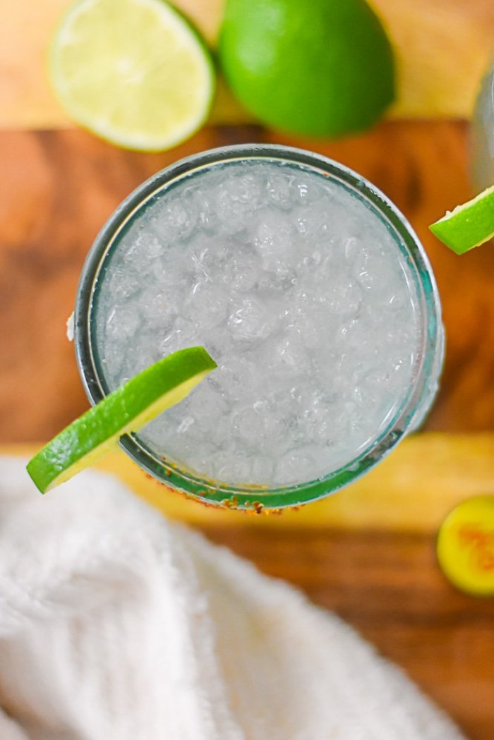 glass of Texas ranch water with mezcal, crushed ice, and a lime slice garnish.
