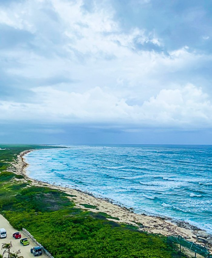 View of beach from Punta Sur lighthouse observation deck.
