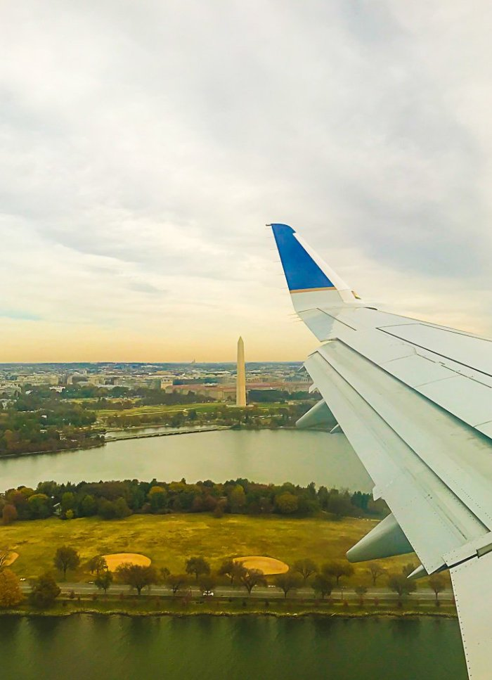 Washington monument viewed out of plane window.