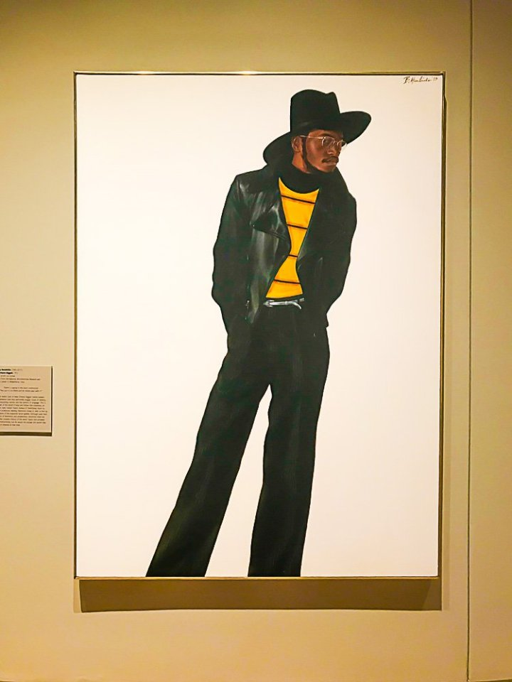 framed painting of a Black man wearing gold rimmed glasses at National Museum of African American Culture and History in DC.