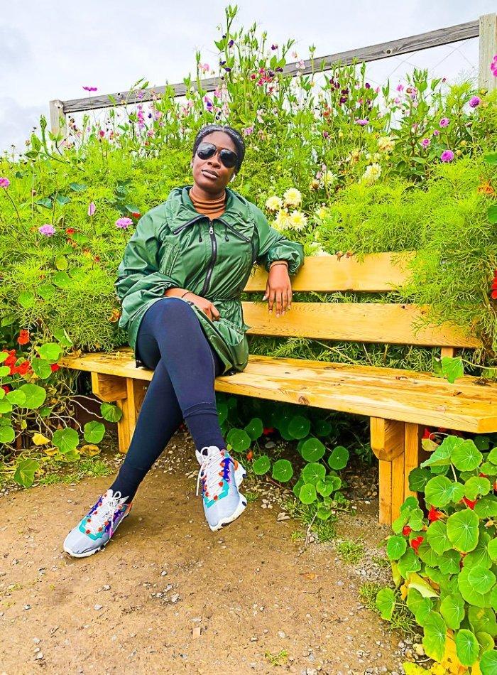 Jazzmine sitting on bench in Georgeson Botanic Gardens.