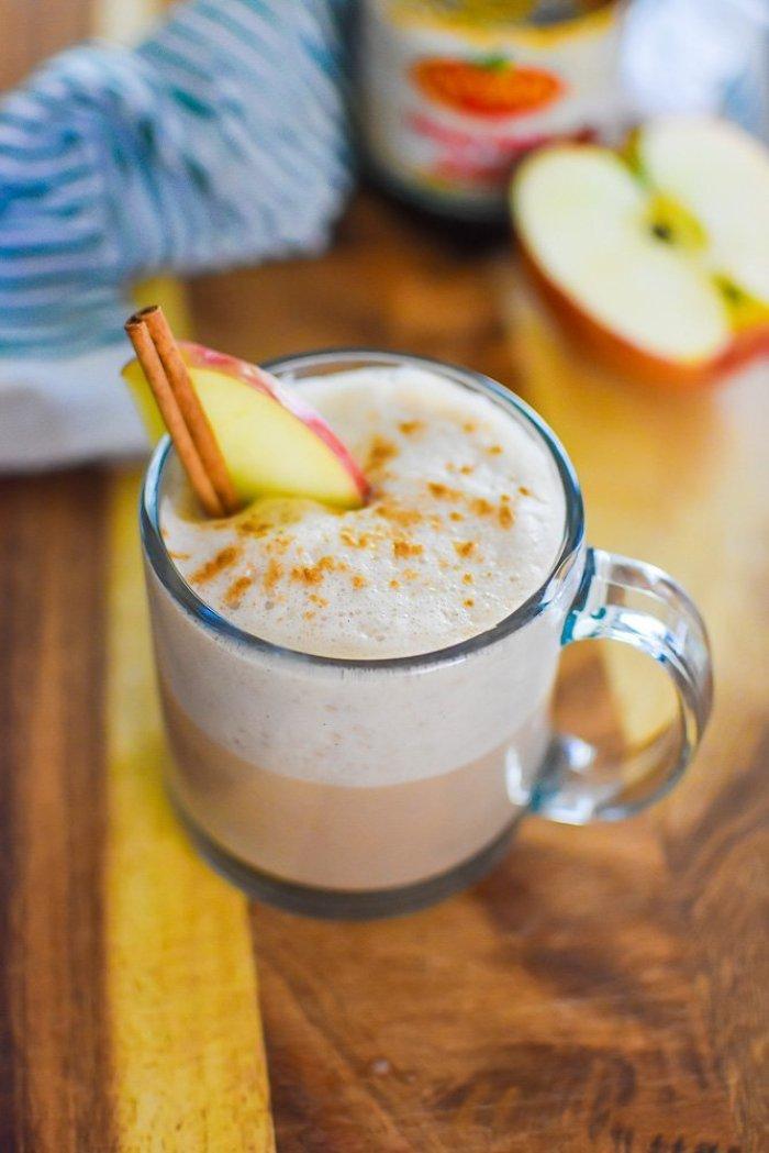 apple butter chai latte in a clear glass muc.