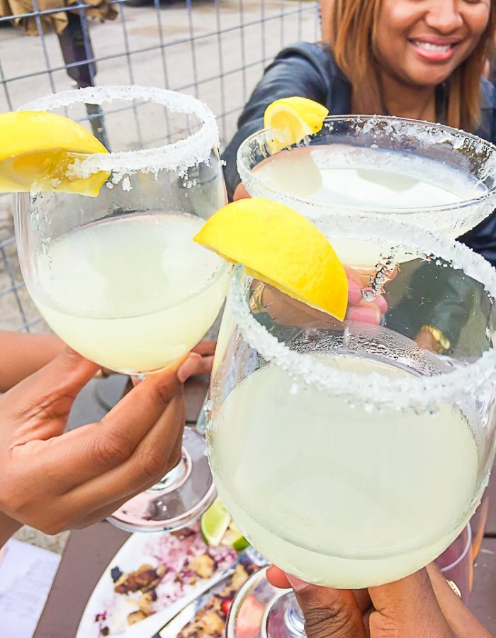 women toasting mimosas at Bar 5015 in Third Ward Houston.