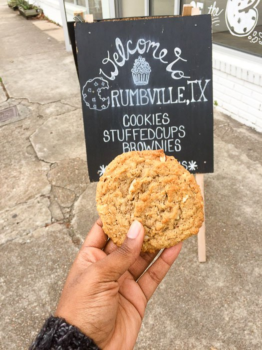 holding cookie outside Crumbville, TX in Third Ward.